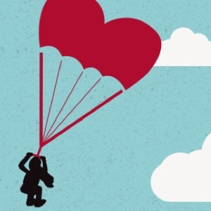 Woman riding a heart shaped parasail