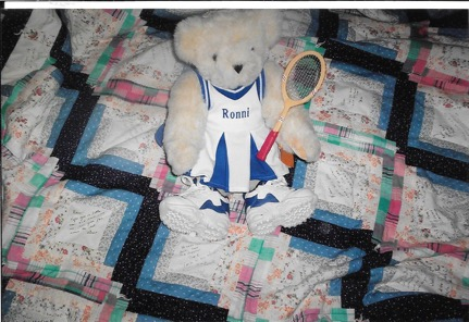 Stuffed animal bear in a tennis outfit
