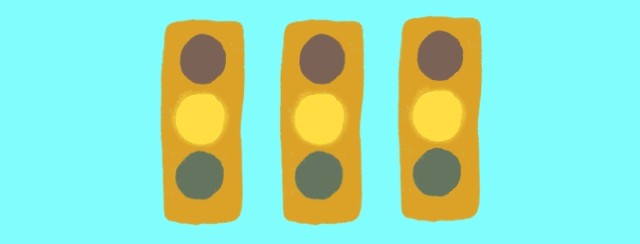 three yellow stop lights