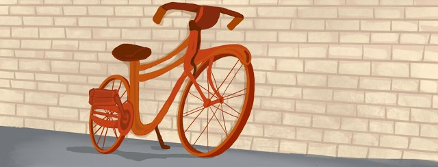 Bicycle leaning up against wall