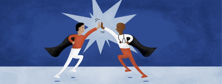 Doctor and patient dressed as superheroes highfiving