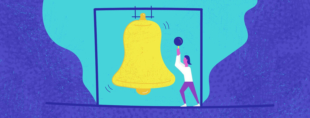Woman ringing a large bell