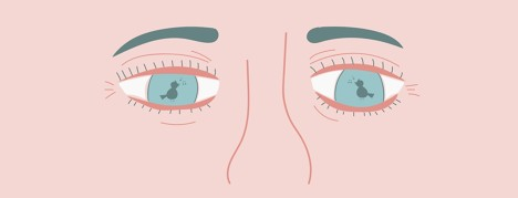 Close up on a person's eyes with a bird singing reflected in them