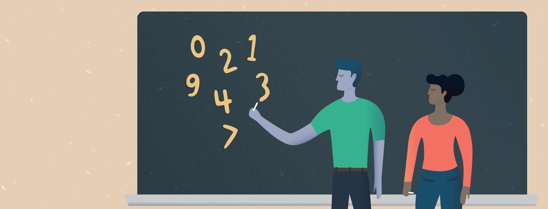 man pointing at numbers on a chalkboard