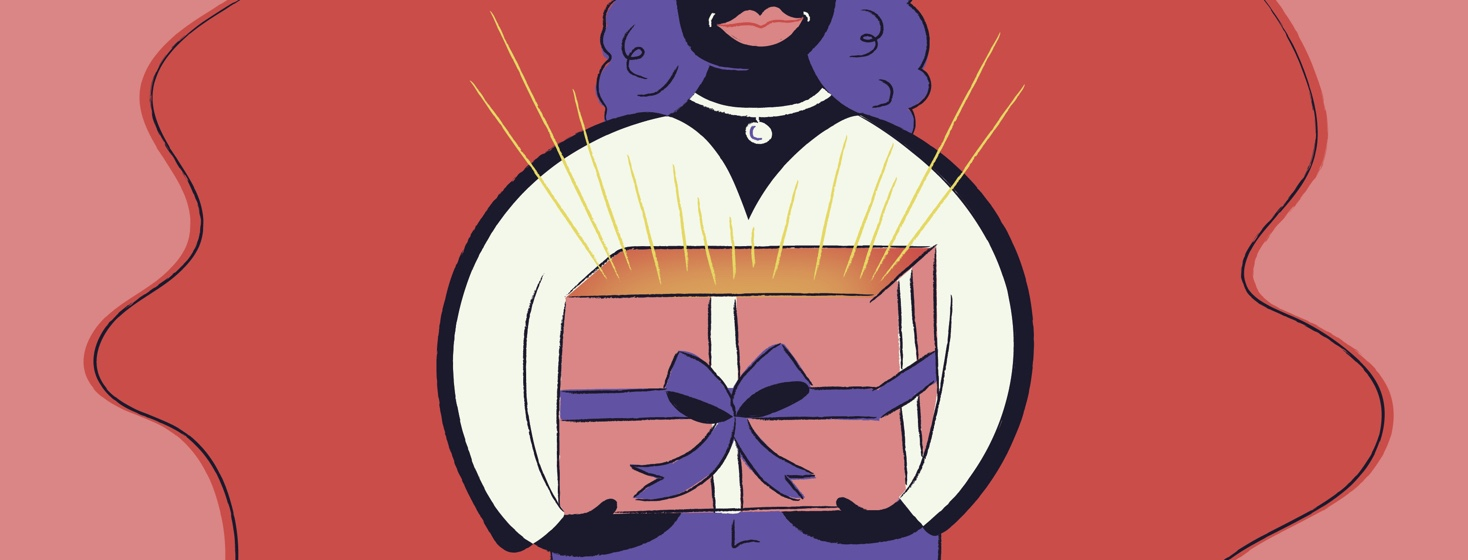 Woman opening a birthday present