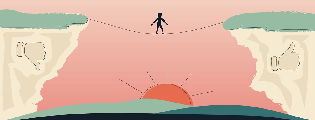 A woman walking on a tightrope away from a thumbs down and towards a thumbs up