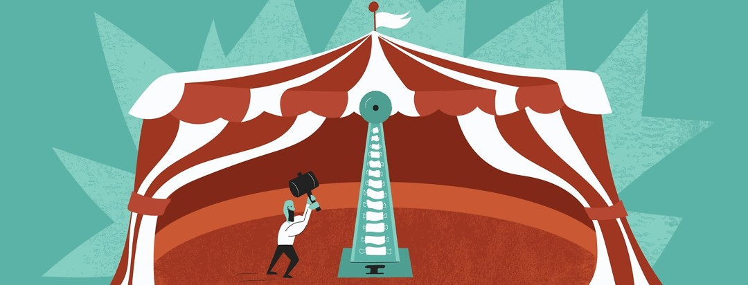 A carnival strength game that looks like a spine in a circus tent and a man about to hit the game with a hammer