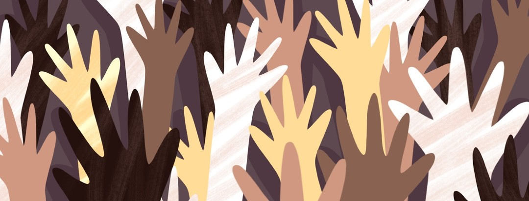 Various hands of diverse races raise into the air