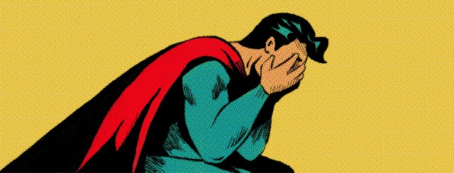 Superman sits with his face in his hands, weeping