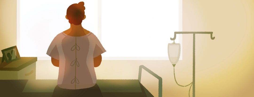 A man in a hospital gown sits on his bed in a hopeful sunrise
