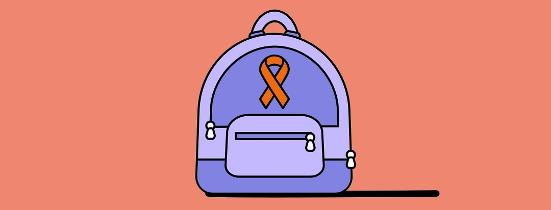 A schoolbag with an orange blood cancer ribbon on it