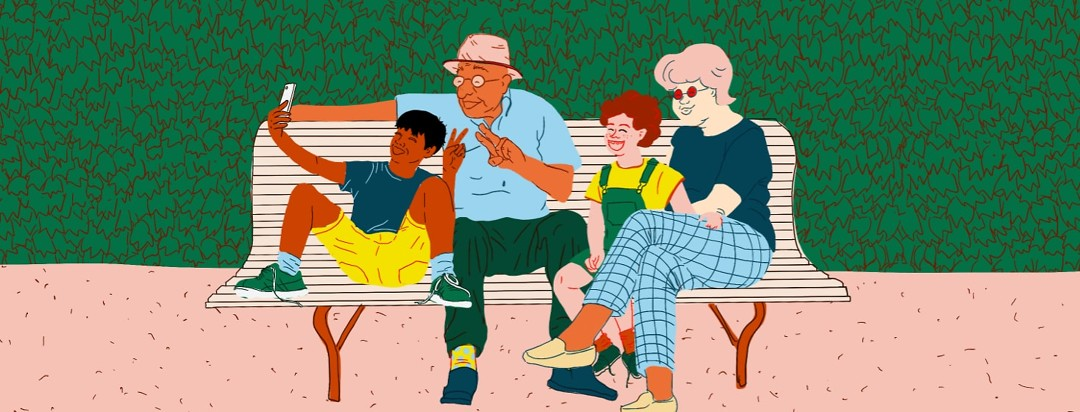 Grandparents taking a selfie with two grandchildren on park bench