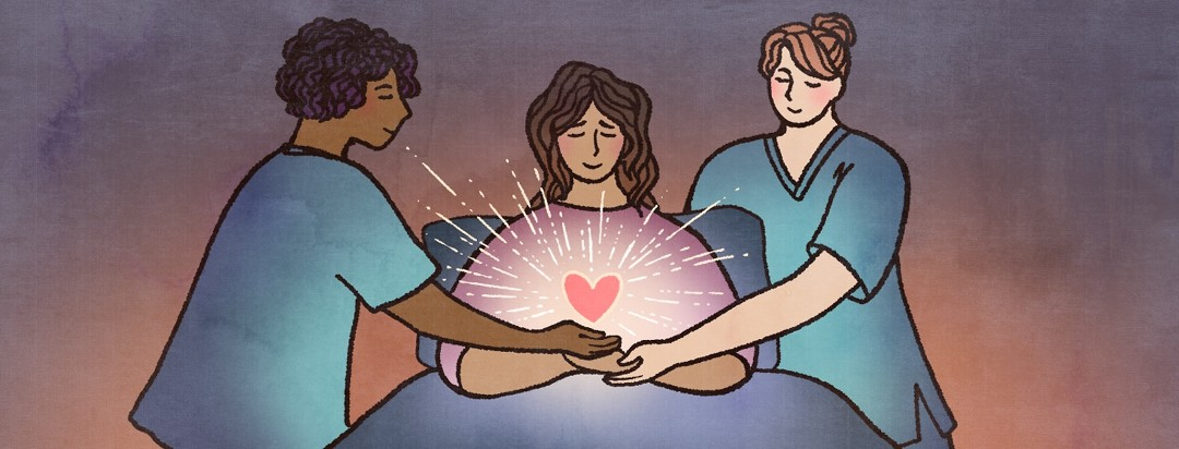 Two nurses help a patient in bed, her heart glows