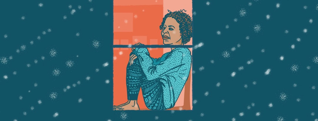 a woman sits alone in a window and watches snow fall outside