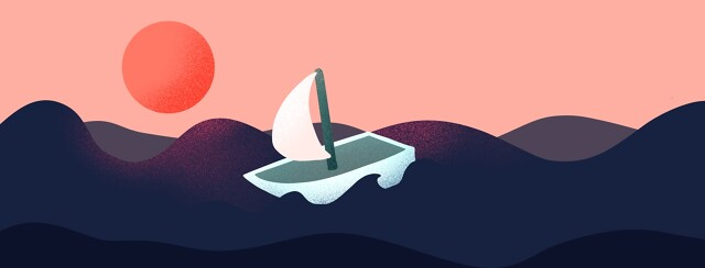 A sailboat on a choppy ocean at sunset