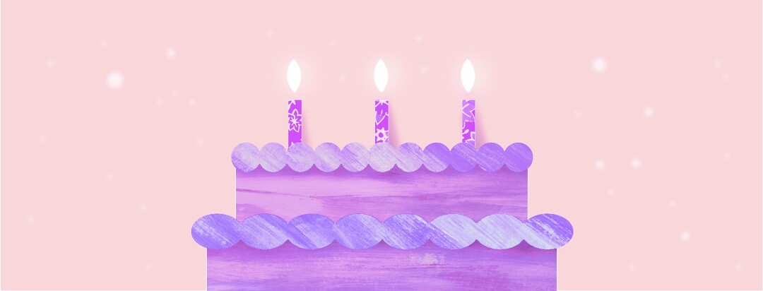 A birthday cake with three candles