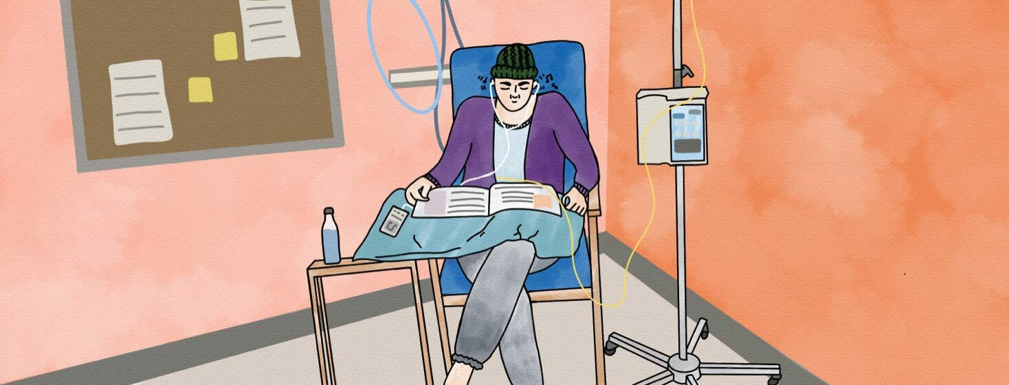 woman in comfortable clothing sitting in chair receiving chemotherapy, while reading a magazine and listening to music.