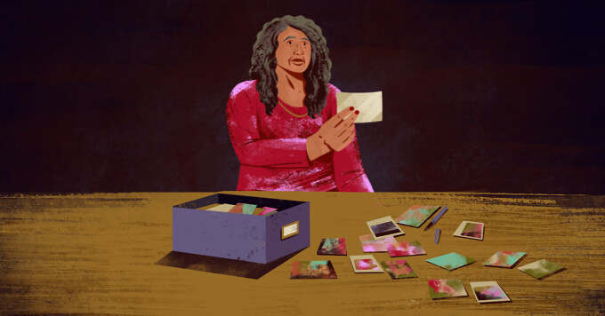 A woman looks through a box of old photos