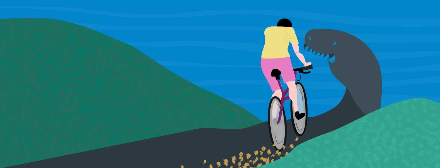 A woman riding her bike down the road that turns into a monster waiting for her