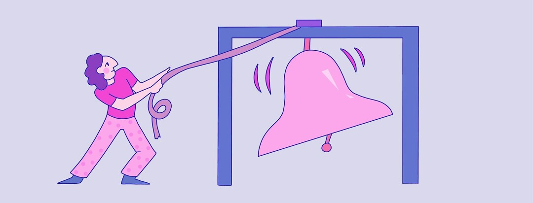 A person ringing a large bell