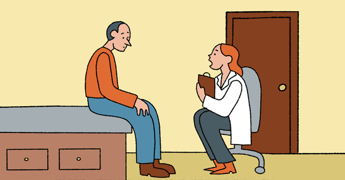 A doctor talking to a patient in an exam room
